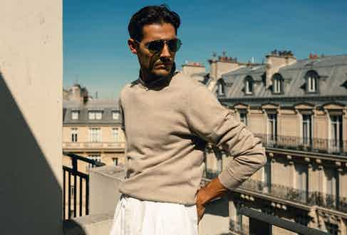 Anderson & Sheppard knit, vintage trousers and sunglasses from Broadway & Sons. Photo by Milad Abedi.