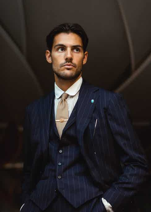 Ring Jacket chalk stripe suit, vintage shirt and tie. Photo by Milad Abedi.