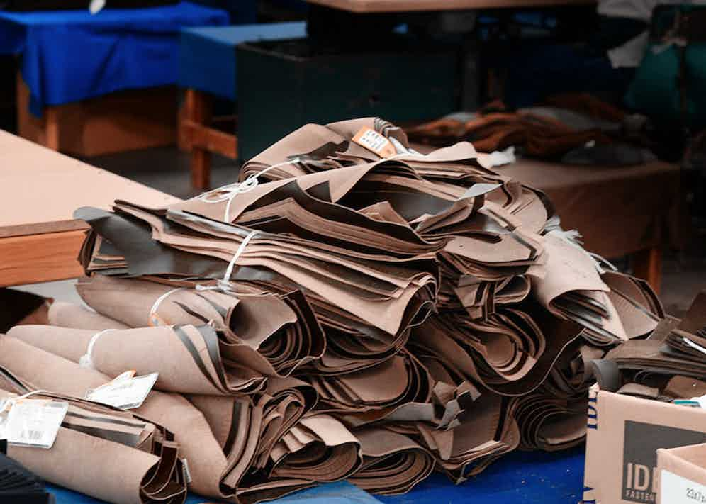 Bundles of parts that have been cut by hand waiting to be assembled.