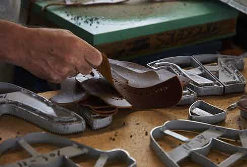 A Tricker's craftsman leather-working.