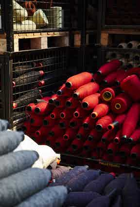 Spun yarns are placed onto bobbins which then are applied to the weaving loom.