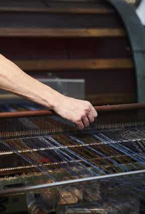 The warp consists of 1,416 yarns which need to be tied end-on-end, which is incredibly time consuming.