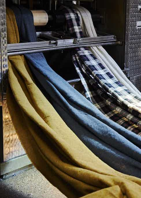 Once the weft has been applied, the tweed is delivered back to the mill to be washed, cleaned and finished. Photo by James Holborow.