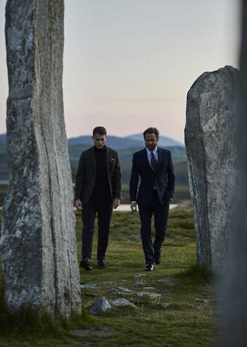 With Mark Hogarth, Creative Director of Harris Tweed Hebrides, walking around the Callanish Stones, Scotland's answer to the Stonehenge. Photo by James Holborow.
