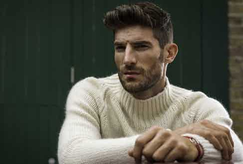 Cream cashmere roll neck, Connolly; 24H Le Mans edition bracelet on red cord, The Mechanist.