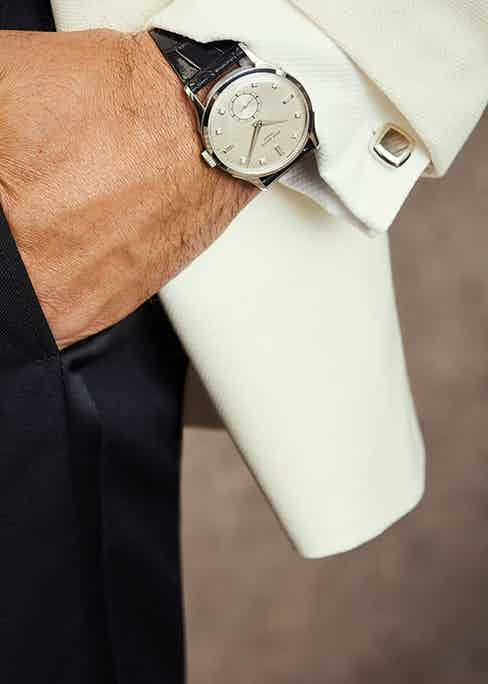 """The Rake's """"Evening"""" ensemble marries a classic white tuxedo jacket with a stunning dress watch."""