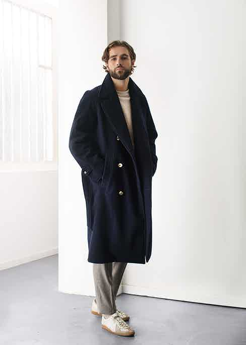 De Bonne Facture's navy wool trench coat is the ultimate winter wardrobe staple.
