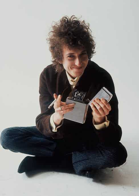Dylan pictured posing in Jerry Schatzberg's photography studio in 1965. © Jerry Schatzberg. Courtesy of ACC Art Books.