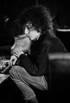 Dylan smoking a cigarette during a break inside Schatzberg's photography studio in the 1960s. © Jerry Schatzberg. Courtesy of ACC Art Books.