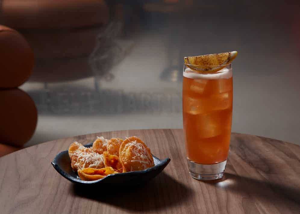 Fish House Punch with Crispy Ravioli of Nduja Sausage and Grated Aged Parmesan.