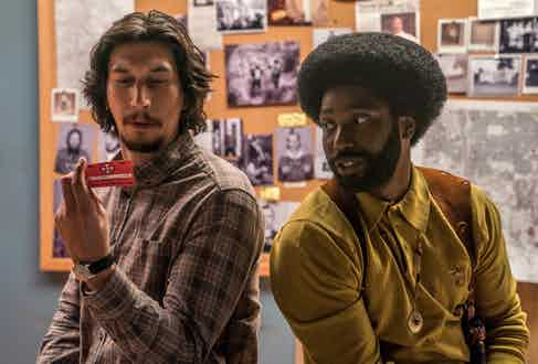 Ron with his coworker Flip Zimmerman (played by Adam Driver).