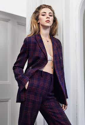 Red and blue virgin wool checked trouser and jacket, both Dior; yellow-gold 18ct diamond and malachite Rose des Vents necklace and yellow-gold 18ct diamond and lapis blue Rose des Vents necklace, both by Dior.