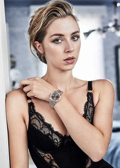 Black lace and mesh dress, Agent Provocateur; Datejust 36mm with dark rhodium dial, Rolex.