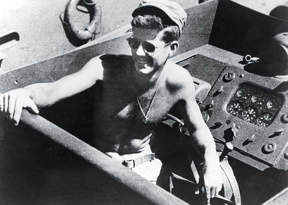Kennedy aboard the torpedo boat he commanded in the second world war as a naval lieutenant.