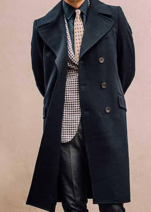 Kit Blake's navy wool overcoat features oversized horn buttons. Photograph by Jamie Ferguson.