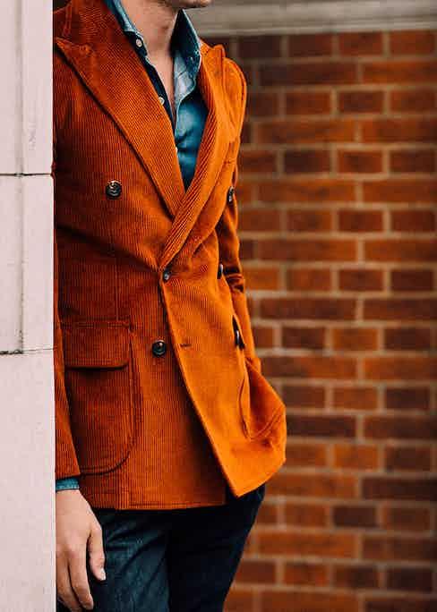 Doppiaa's blood orange corduroy blazer is a striking option to pair with contrasting hues.