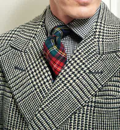 "This tie's ""Black Stewart"" tartan is an iteration of the ""Royal Stewart"" tartan designed by Queen Victoria's husband Prince Albert in 1853."
