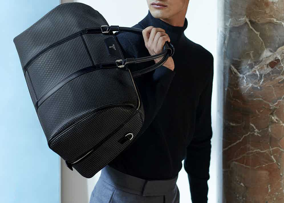 Proudly made in Italy by skilled leather craftsmen, this travel holdall by Serapian has been crafted from waterproof Stepan spread cotton with calf leather detailing.