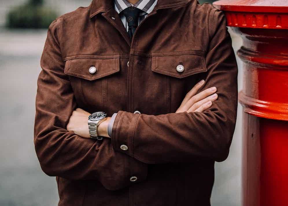 The dark brown trucker jacket comes with gunmetal hardware which offers a nice point of difference and contrast. Photo by Jamie Ferguson.