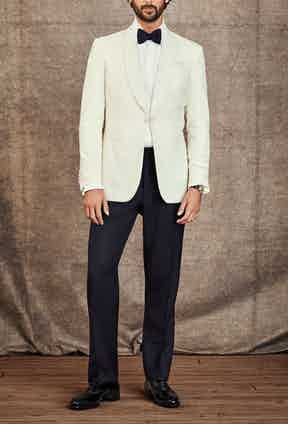 Eveningwear: Suit by Gieves & Hawkes; Shirt by Turnbull & Asser; Bow tie by Cifonelli; Shoes by George Cleverley; Cufflinks by Deakin & Francis; Watch is a Patek Philippe circa 1950 with a possibly unique reference in platinum with a diamond-set dial.