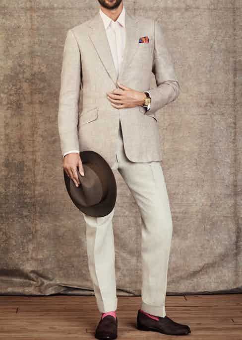 The Watch Enthusiasts' Gathering: Jacket by Huntsman; Shirt by Emma Willis; Pocket Square by Rubinacci; Hat by Lock & Co; Trousers by Edward Sexton; Socks by The London Sock Company; Loafers by Cheaney; Watch is a Rolex 'Padellone' ref 8171, circa 1951 with two-tone dial in 18k yellow gold.