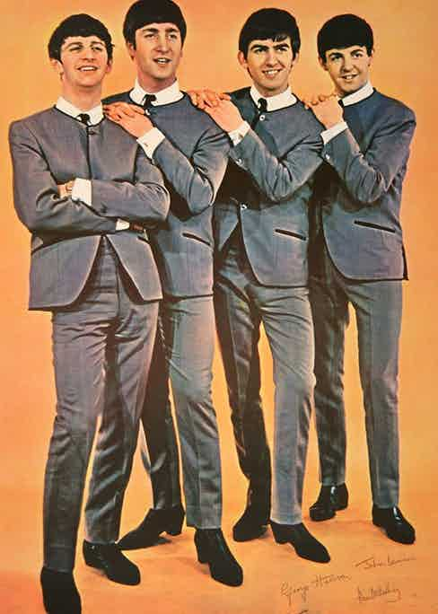 The band in their matching collarless suits, inspired by Pierre Cardin and produced by Dougie Millings.
