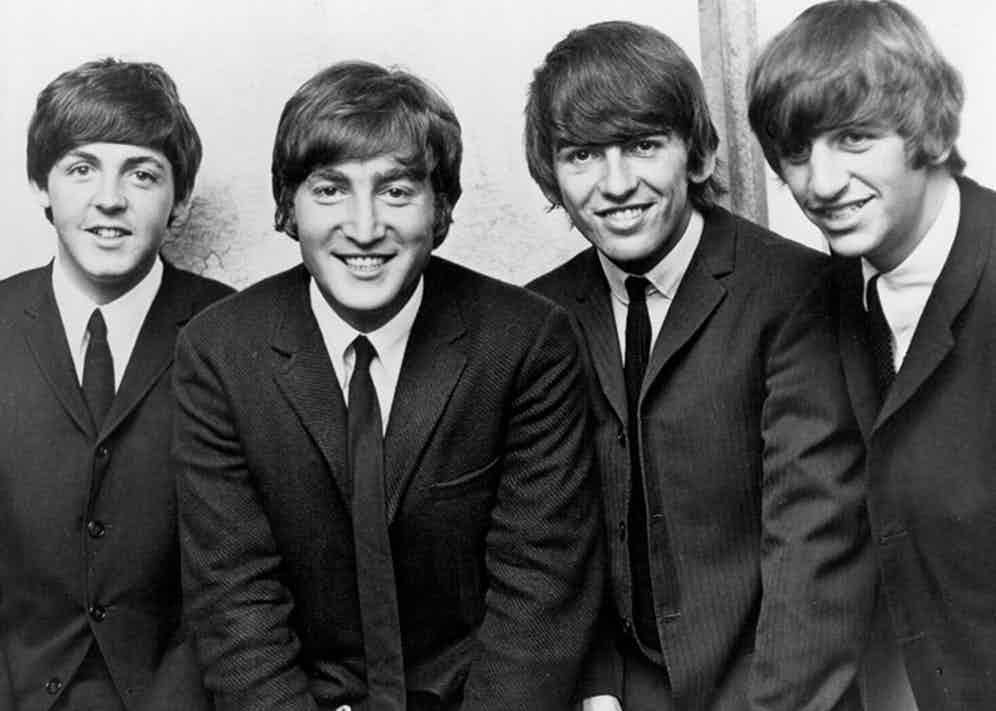Skinny black ties, crisp white shirts and dark grey single-breasted suits formed the basis of the Beatles' early outfitting.
