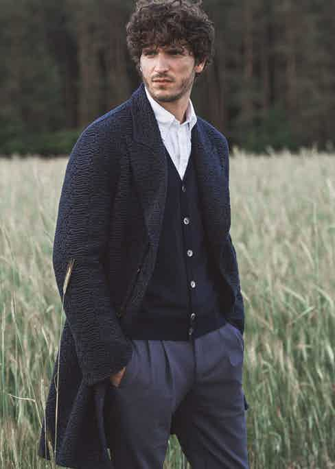 Midnight blue embroidered wool coat, Ermanno Scervino; navy striped merino wool cardigan, Corneliani; white seersucker shirt, Drake's; navy blue wool military pants, Pal Zileri; steel grey and black camouflage print calf leather laceup Hill boots, Santoni. Styling by Jo Grzeszczuk, photograph by Simon Lipman.