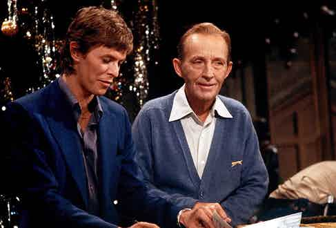 Bing Crosby, pictured here with David Bowie, was a proud proponent of the classic cardigan.