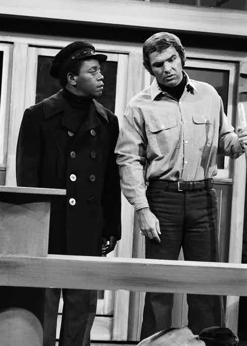 Flip Wilson and Burt Reynolds, circa 1971. Photograph by Getty Images.
