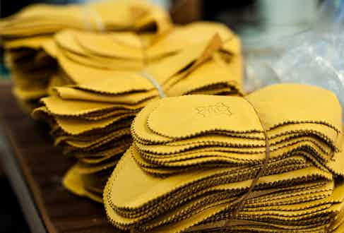 Fabrics are hand cut using the specific Undandy shoe model and style.