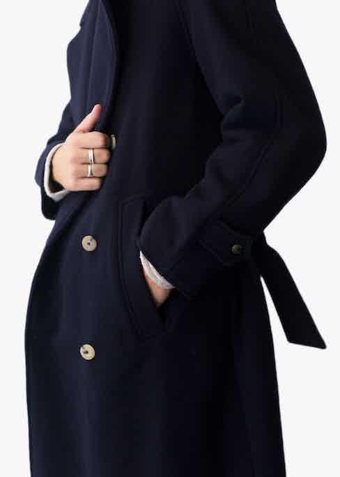Navy blue wool trenchcoat.