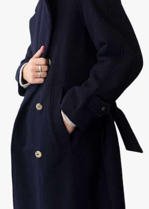 Navy blue wool trenchcoat.