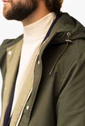Olive water-repellent cotton parka.