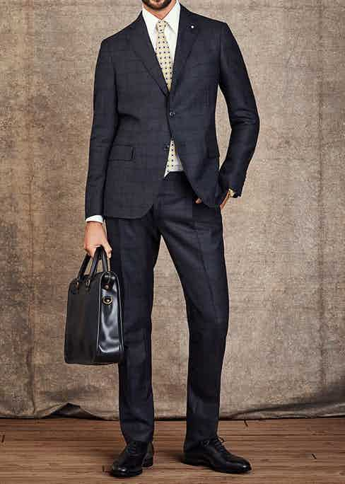 Business: Suit by Lardini; Shirt by Turnbull & Asser; Tie by Drake's; Case by Ettinger; Shoes by Edward Green; Watch is a Patek Philippe 1928 single pusher 'Officer' chronograph with Breguet numerals in 18K yellow gold.