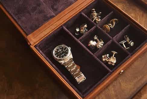 A small selection of Deakin & Francis cufflinks kept away in a befitting cufflink box.