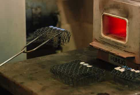 Once the enamel has been applied by hand, it's placed within the furnace which bring out the wonderful shine.