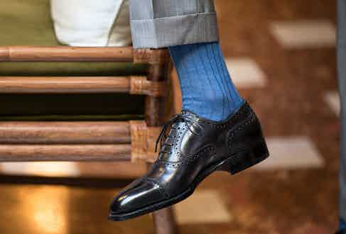 A slick pair of Oxfords worn with a brightly coloured sock makes for an arresting business-appropriate look.