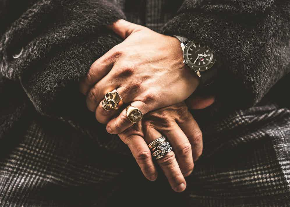 Wei wears Black teddy bear coat, Motoluxe; Black Prince of Wales bespoke suit, Cifonelli; Black wool polo shirt, John Smedley; Black Newmarket leather Chelsea boots, Edward Green; Hyperchrome 'Ghost Captain' dive watch, Rado x The Rake x Revolution.