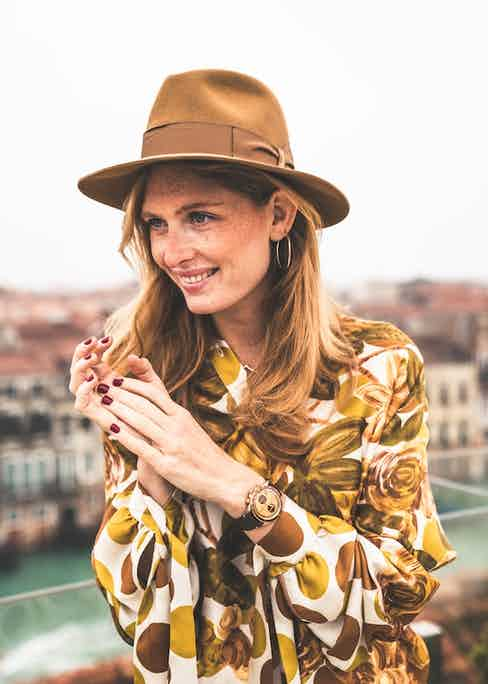 Eleonor wears the Bell & Ross 'El Mirage' Bellytanker chronograph.