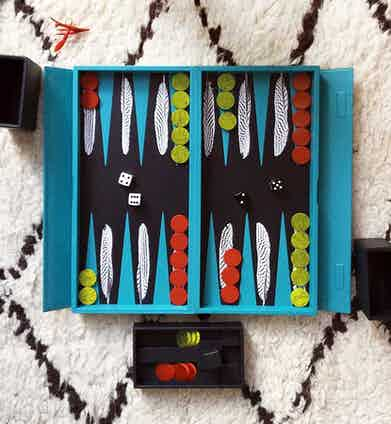 The Turquoise Leather Silver Pheasant Travel Backgammon set will keep you entertained on the go.