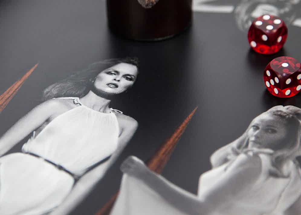 Details of the Terry O'Neal Goddesses Backgammon Set, which features icons such as icons such as Bridget Bardot, Raquel Welch, Ursula Andress, Goldie Hawn, Jean Shrimpton, Audrey Hepburn and Twiggy.