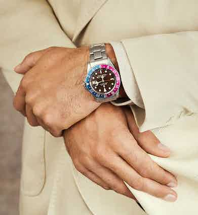 The Rolex 1965 GMT-Master features a tropical gilt glossy dial in stainless steel.