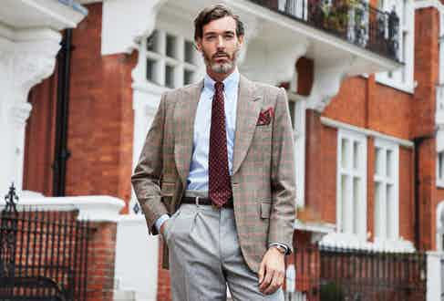 Richard Biedul wears an Edward Sexton Prince of Wales check sports jacket designed exclusively for The Rake, with Edward Sexton's Hollywood-top trousers. Photo by James Munro.