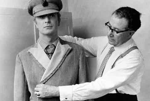 Michael Caine being fitted by his tailor, the celebrated Doug Hayward.