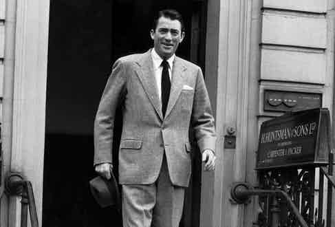 Gregory Peck leaves H. Huntsman & Sons at No. 11 Savile Row.