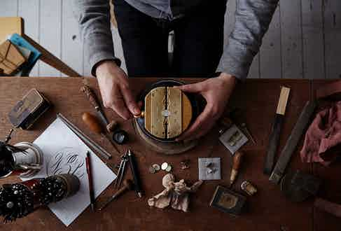 Each ring is secured in specialised clamps to allow for its design to be hand-drawn onto the surface.