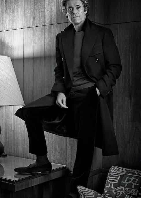 Black wool double-breasted coat and black wool trousers, both Ralph Lauren Purple Label; navy wool jumper, Gieves & Hawkes; black wool socks, Pantherella at The Rake; black velvet slippers, Dolce & Gabbana.