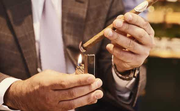 Holy Smokes: How To Light Your Cigar