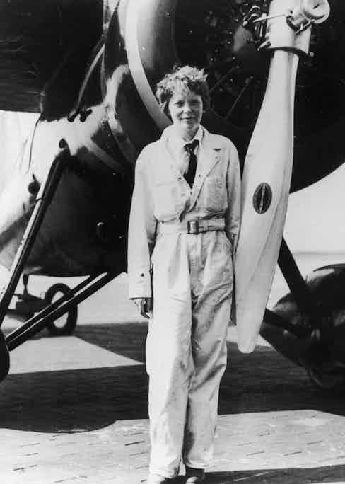 Amelia Earhart in front of her Lockheed plane Electra, circa 1933. (Photo by Fotosearch/Getty Images).